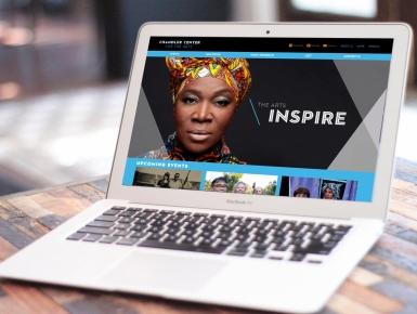 Chandler Arts Website on Laptop in Cafe
