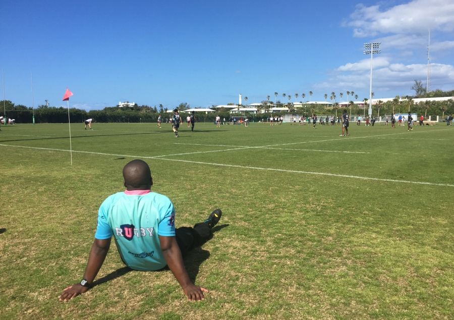 referee sits to watch the ongoing rugby event