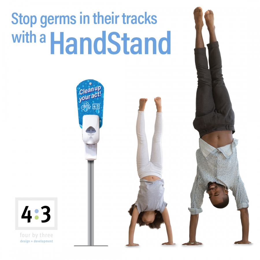 father and daughter doing a hand stand next to a HandStand dispenser
